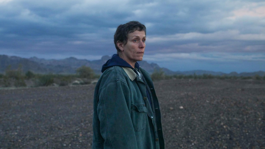 Nomadland, frances mcdormand, movie review header woman alone in large desert